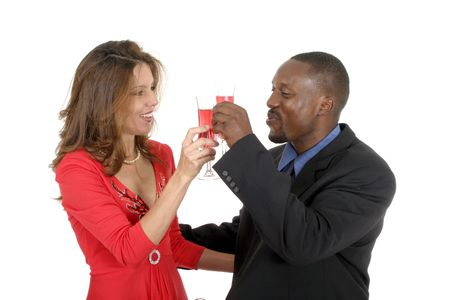 Handsome man and beautiful woman celebrating a romantic occasion with a bottle of champagne or sparking wine. photo