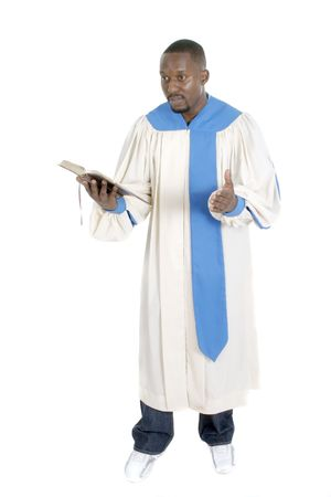 Man wearing a robe, holding a Bible, and preaching. photo