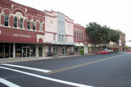 Typical downtown main street complete with furniture store and movie theater that could be almost any town in the Mid West United States. Stock Photo