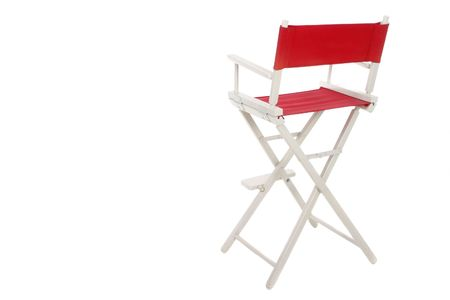 collapsible: Directors chair with red seat and back on a white frame. Isolated on white background.  Copyspace room on left for text. Stock Photo