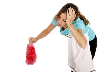 Tired or frustrated maid housekeeper with one hand on her head dusting an unseen object.