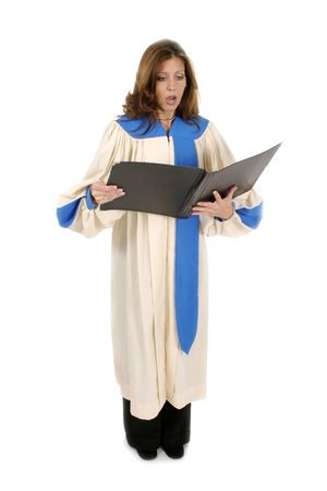 a white robe: Beautiful woman church choir member in choir robe holding a music folder and singing.  Isolated on white.