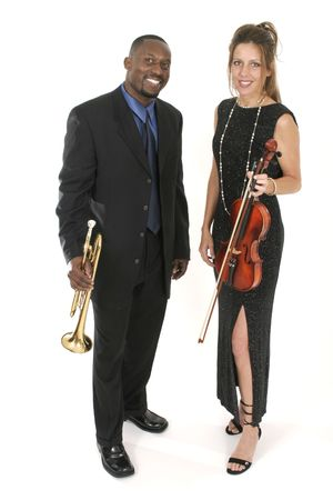 A beautiful female violinist and a handsome male trumpet player standing together holding their instruments.  Shot isolated on white background.
