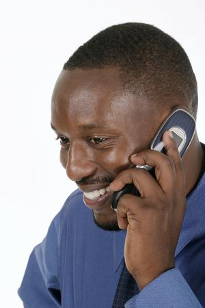 Smiling professional, business man, teacher, or medical doctor smiling and talking on a cellphone. Stock Photo