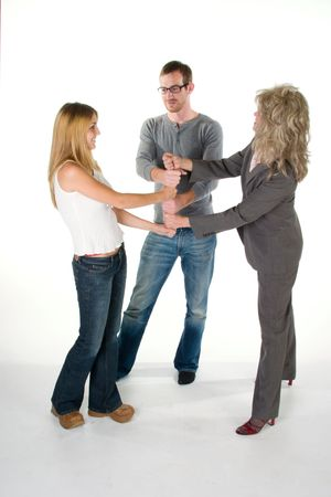 Three person business team with fists interlocked in a stack. photo