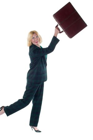 Smiling Ecstatic woman ready to throw her briefcase away after successfully completing a tough task! Imagens