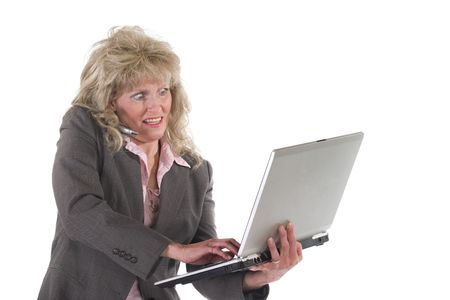 concede: Attractive executive business woman standing up holding a laptop computer and talking on a cell phone.