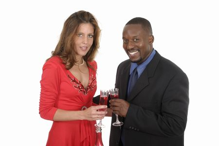 Man and woman celebrating a romantic occasion with a bottle of champagne or sparkling wine.