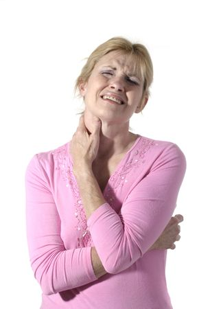 Beautiful and attractive mid forties woman with severe neck pain rubbing her neck with her hand.  Portrait orientation.  Shot isolated on white.