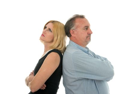 ignoring: Man and woman standing back to back in an argument. Stock Photo