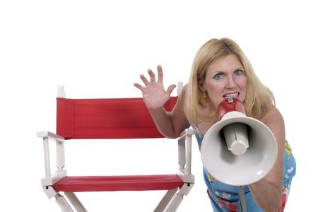 Beautiful and glamorous woman sitting in red directors chair holding a megaphone.  Shot isolated on white.