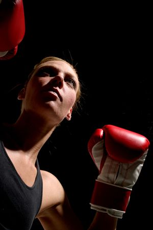 Young attractive blonde woman boxing. photo