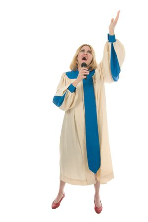 choral: Blond woman in a choir robe holding a microphone and singing.