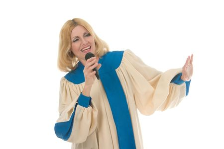 hymnal: Blond woman in a choir robe holding a microphone and singing.