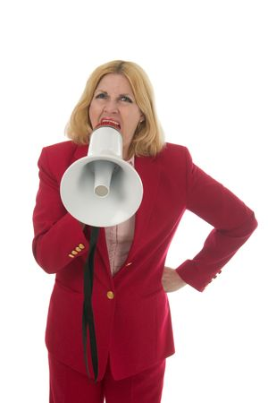 harass: Attractive executive business woman making her point really clear with the aid of a megaphone.