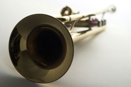 closeup of trumpet bell with focus on bell; brass lacquered trumpet
