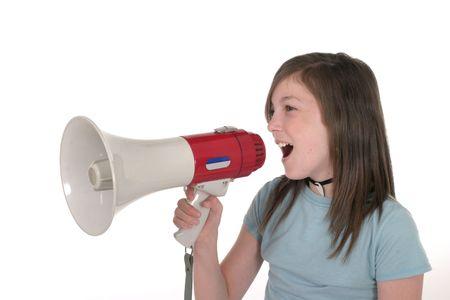 pre teen: Young pre teen or tween girl shouting, speaking, or singing through a megaphone. Shot on white