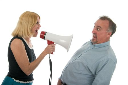 whine: Extreme domestic argument with wife shouting commands through a megaphone at her fearful husband. Stock Photo
