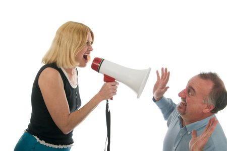 Extreme domestic argument with wife shouting commands through a megaphone at her husband.