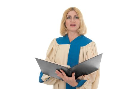 Blond woman in a choir robe holding a music notebook and singing. photo