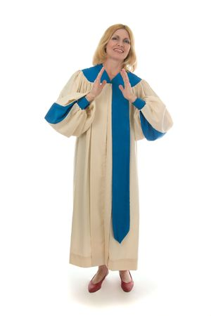 Blond woman in a choir robe singing, smiling, praising the Lord, and clapping. photo