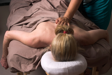 Beautiful woman receiving relaxing massage at home