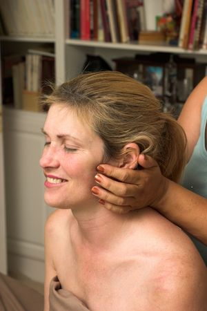 Beautiful woman receiving relaxing massage at home Stock Photo - 800153