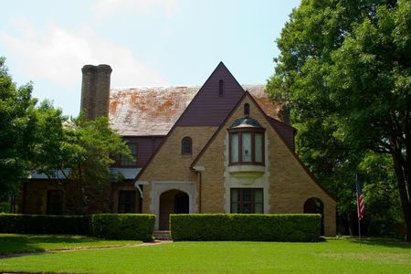 Tudor Style brick house with dramatically pitched roofline