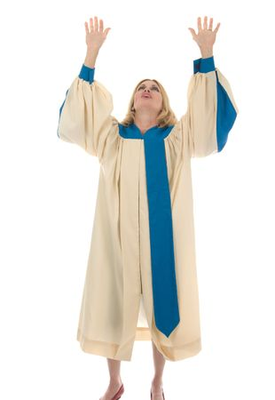 Blond woman in a choir robe Praying and Praising the Lord. photo