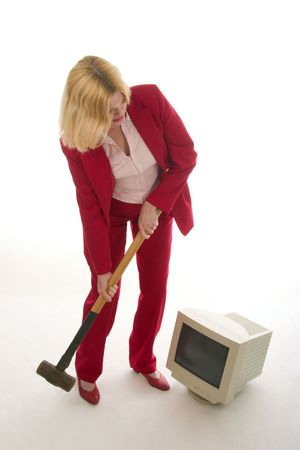 Frustrated Woman About to Smash Monitor with Sledgehammer. photo