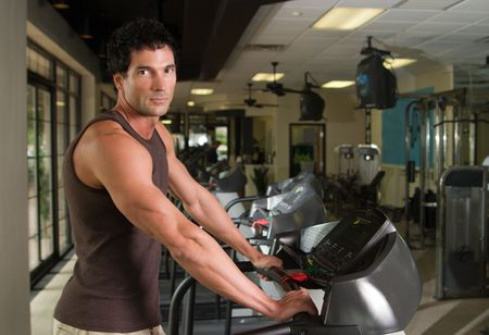 cardiovascular workout: Man working out on a treadmill in a fitness center. Stock Photo