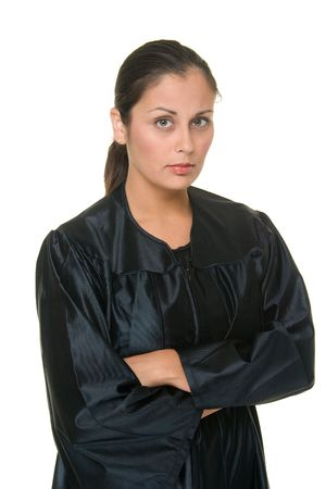 female judge: Beautiful Hispanic woman judge in black judicial robes standing with her arms crossed.