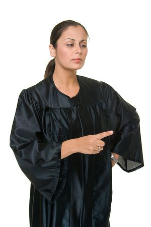 judicial: Beautiful Hispanic woman judge in black judicial robes standing and gesturing by pointing with her index finger.