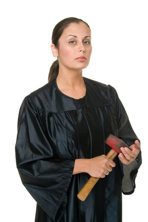 Beautiful Hispanic woman judge in black judicial robes holds a real sledge hammer ready to administer justice.