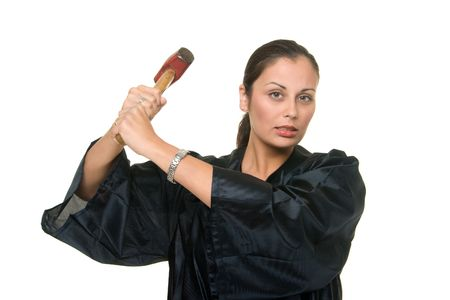 Beautiful Hispanic woman judge in black judicial robes wielding a real sledge hammer ready to administer justice.