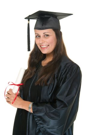 Very happy and proud beautiful young woman standing in graduation robes, cap and gown smiling and holding her diploma or degree. The graduate has moved the tassle from the left to the right side of the mortarboard.