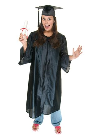 Very excited and happy beautiful young woman standing in graduation robes, cap and gown smiling and holding her diploma or degree. The graduate has moved the tassle from the left to the right side of the mortarboard. photo
