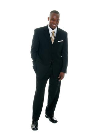 persona de pie: Apuesto hombre de negocios en traje negro.  Foto de archivo