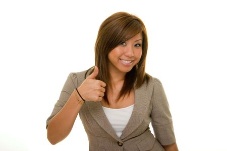 Young Asian woman in business suit raising thumb in joy over accomplishment.
