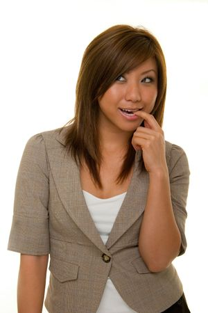 Beautiful young Asian business woman in business suit thinking. photo