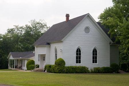 rural town: A simple white wooden church in a rural town. Stock Photo