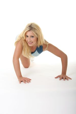 pushups: Attractive young blonde woman doing pushups, exercising, and working out.