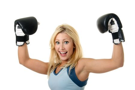 Beautiful blonde woman with black boxing gloves on a white background. Stock Photo
