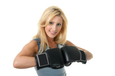 Beautiful blonde woman with black boxing gloves on a white background. Imagens
