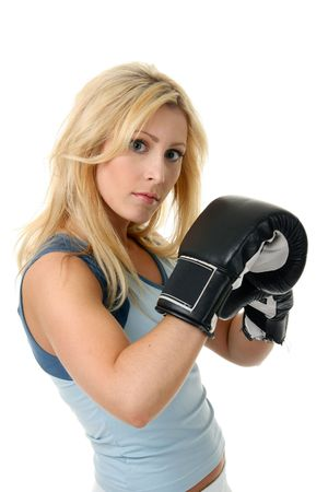 Beautiful blonde woman with black boxing gloves on a white background. photo