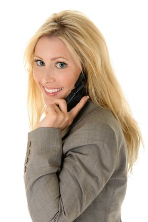 Beautiful blonde woman on a cellphone looks over her shoulder with a cheerful, smiling facial expression. Stock Photo - 3289725
