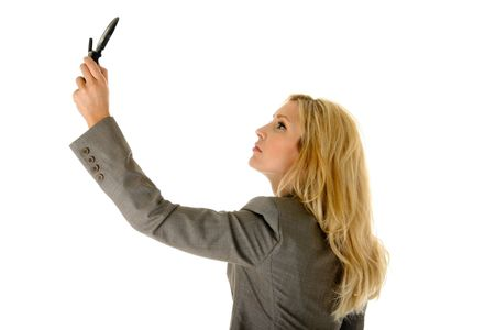 Beautiful blonde woman is holding a cellphone extended as if trying to get a better wireless signal. Stock Photo - 3289714