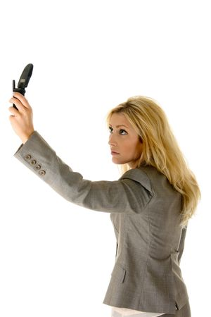as: Beautiful blonde woman is holding a cellphone extended as if trying to get a better wireless signal.