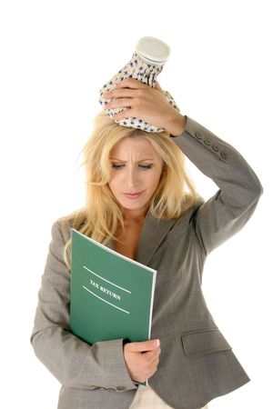 Beautiful blonde woman is treating her tax headache with an ice pack on her head. Other text could be substituted for the  Stock Photo