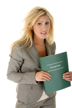 Beautiful blonde woman is shocked and bewildered by her tax return problems. Other text could be substituted for the